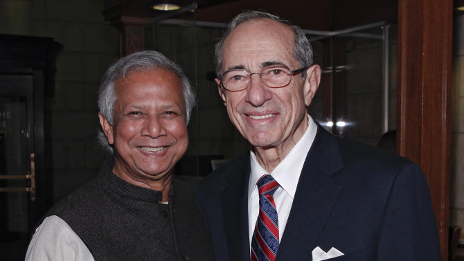 COMMERCIAL IMAGE - In this photograph taken by AP Images for Hult International Business School, Nobel Prize winner Muhammad Yunus and former New York Governor Mario Cuomo appear at the Hult Global Case Challenge on Thursday, April 26, 2012 in New York. The Challenge's two judges worked together to help solve poverty. (Brian Ach /AP Images for Hult International Business School)