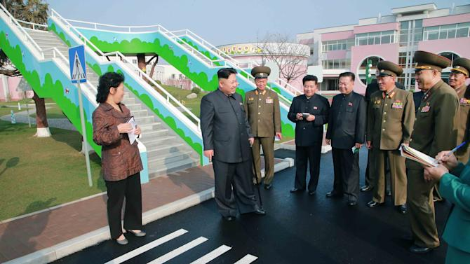 KCNA handout of North Korean leader Kim Jong Un giving field guidance during his visit to the Pyongyang Baby Home and Orphanage