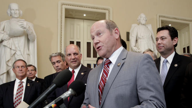 "Rep. Reid Ribble, R-Wis., and other House Republicans speak about passage of the conservative deficit reduction plan known as ""Cut, Cap and Balance"" in the GOP-controlled House, on Capitol Hill in Washington, Tuesday, July 19, 2011. (AP Photo/J. Scott Applewhite)"