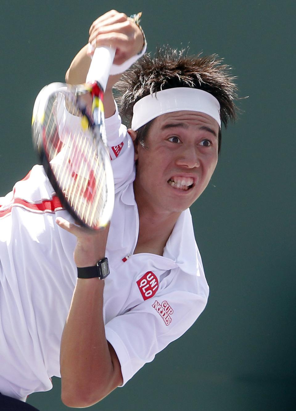 Kei Nishikori, of Japan, serves to Rafael Nadal, of Spain, during the Sony Ericsson Open tennis tournament, Tuesday, March 27, 2012, in Key Biscayne, Fla. (AP Photo/Wilfredo Lee)