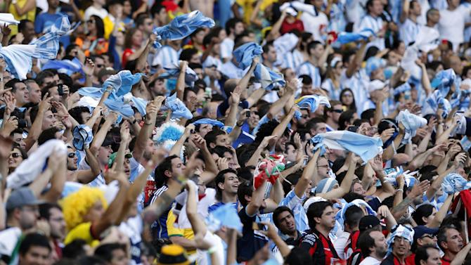 Argentina supporters cheer during the group F World Cup soccer match between Argentina and Iran at the Mineirao Stadium in Belo Horizonte, Brazil, Saturday, June 21, 2014. (AP Photo/Victor R. Caivano)