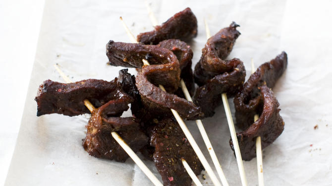In this image taken on January 7, 2013, sweet and sticky slow cooked short ribs served on skewers are shown in Concord, N.H. (AP Photo/Matthew Mead)