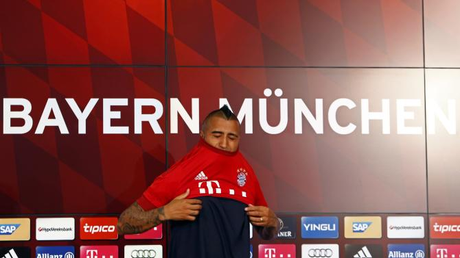 Chile's Vidal, Bayern Munich's new signing, tries out his new jersey at the Allianz Arena in Munich
