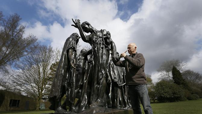 Conservator Rupert Harris waxes Rodin's 'The Burghers of Calais' after it is installed at The Henry Moore Foundation in Much Hadham, Hertfordshire, Monday, March 18, 2013. The sculpture, which normally stands outside Parliament in London, was installed to go on show in 'Moore Rodin' a major exhibition bringing together work from the two artists.(AP Photo/Kirsty Wigglesworth)
