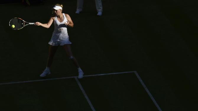 Caroline Wozniacki of Denmark hits a shot during her match against Saisai Zheng of China at the Wimbledon Tennis Championships in London