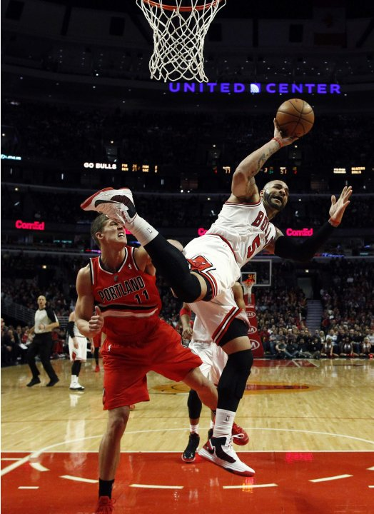 Chicago Bulls' Carlos Boozer goes to the basket against Portland Trail Blazers' Meyers Leonard during their NBA basketball game in Chicago