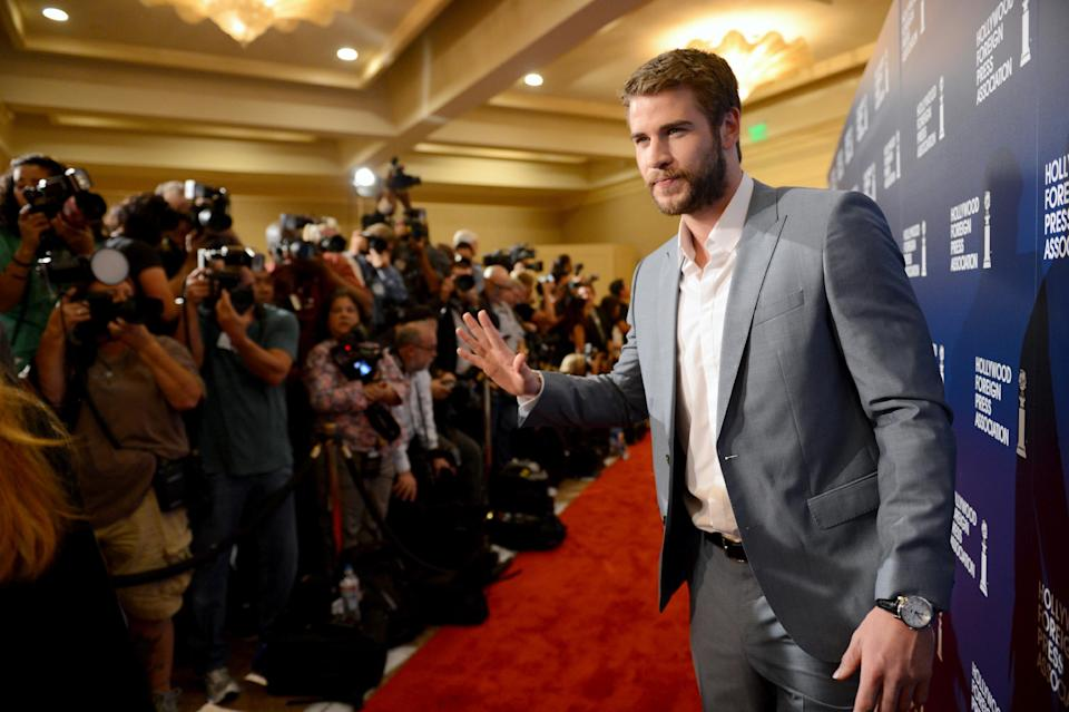 Liam Hemsworth arrives at the Hollywood Foreign Press Association Luncheon at the Beverly Hilton Hotel on Tuesday, Aug. 13, 2013, in Beverly Hills, Calif. (Photo by Jordan Strauss/Invision/AP)