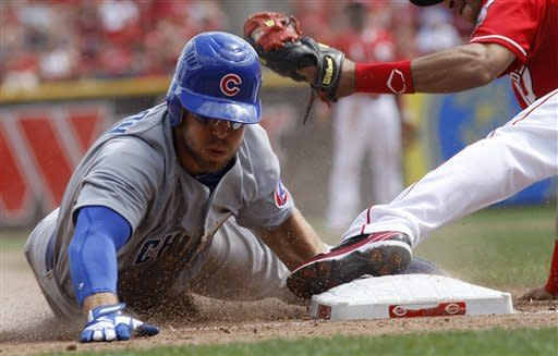 Paul, Hanigan deliver in 9th, Reds beat Cubs