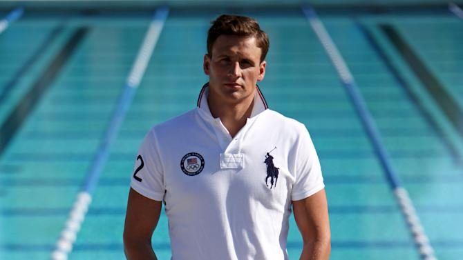 In this Nov. 14, 2011 photo, Olympic medalist swimmer Ryan Lochte models a Ralph Lauren Olympic uniform during a photo session at the University of California-Irvine. Decathlete Bryan Clay spends his days in spandex, while Ryan Lochte pulls on a swimsuit like he's been doing since he was 8 years old. They'll be looking a lot spiffier, along with the rest of the U.S. Olympic team, at next year's London Games. (AP Photo/Reed Saxon)