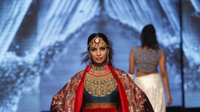 A Pakistani model presents creations by designer Huma Adnani, during Pakistan Fashion Week, in Karachi, Pakistan, Wednesday, Nov. 26, 2014. (AP Photo/Shakil Adil)