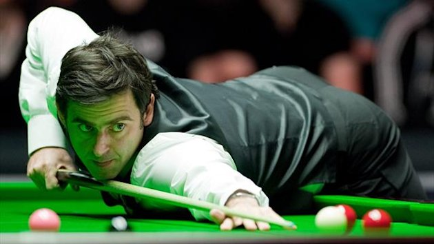 Ronnie O&#39;Sullivan of England plays a shot against Ding Junhui of China during the first round match in the BGC Masters snooker tournament at Alexandra Palace in north London on January 15, 2012