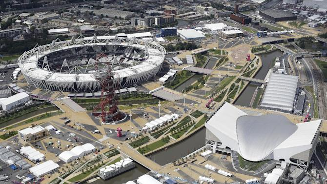 An aerial view of the London 2012 Olympic Park, with the Olympic stadium top left, with the Accor Mittal 'Orbit' Tower, centre, the Aquatic centre, bottom  left, and the Water Polo pool just above the aquatics centre seen Friday, July 13, 2012. (AP Photo/Alastair Grant)