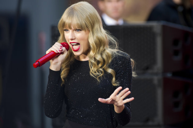 FILE - This Oct. 23, 2012 file photo shows Taylor Swift performing on ABC&#39;s &quot;Good Morning America&quot; in New York. Swift will co-host The Grammy nominations concert with LL COOL J on Wednesday, Dec. 5, in Nashville, Tenn. (Photo by Charles Sykes/Invision/AP, file)