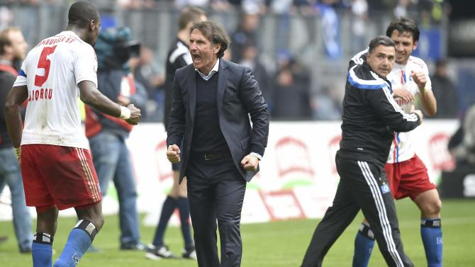 Hamburg SV's head coach Labbadia shouts as he and player Djourou celebrate after the German Bundesliga first division soccer match against FC Augsburg in Hamburg