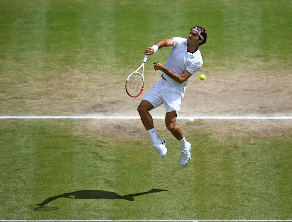 Roger Federer of Switzerland serves to Andy Murray of Britain during the men's singles final match at the All England Lawn Tennis Championships at Wimbledon, England, Sunday, July 8, 2012. (AP Photo/Paul Gilham, Pool)