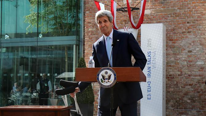 U.S. Secretary of State John Kerry informs the media in front of Palais Coburg where closed-door nuclear talks with Iran take place in Vienna, Austria, Sunday, July 5, 2015. (AP Photo/Ronald Zak)