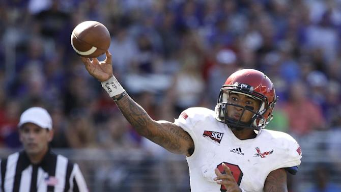 In this Sept. 6, 2014, file photo, Eastern Washington quarterback Vernon Adams Jr. throws a pass against Washington Huskies in the second half of an NCAA college football game  in Seattle. Eastern Washington's record-setting quarterback says he has received a scholarship offer from Oregon and will visit the school this weekend. Adams told The Spokesman-Review on Wednesday, Jan. 28, 2015, that he will fly to Eugene, Oregon, on Friday and return Sunday