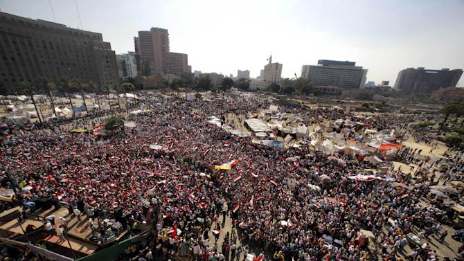Opponents of Egypt's Islamist President Mohammed Morsi shout slogans during a protest in Tahrir Square in Cairo, Egypt, Wednesday, July 3, 2013. Egypt's military moved to tighten its control on key institutions Wednesday, even putting officers in the newsroom of state TV, in preparation for an almost certain push to remove the country's Islamist president when an afternoon ultimatum expires.(AP Photo/Amr Nabil)