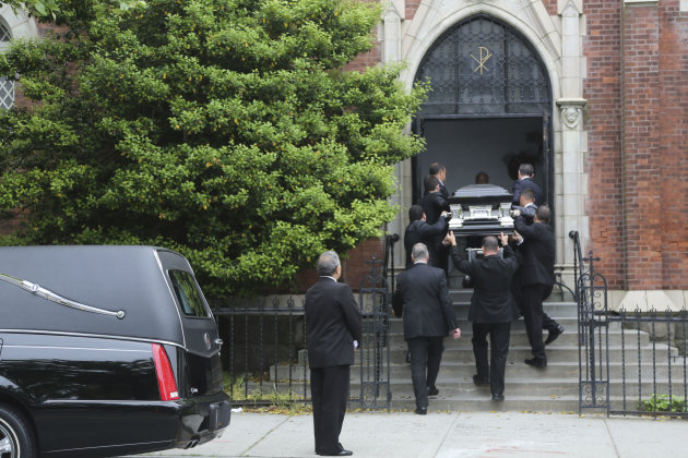 Pallbearers carry Andrea Rebello's coffin into St. Teresa of Avila Church for her funeral service, Wednesday, May 22, 2013 in Sleepy Hollow, N.Y. Police said Rebello, a junior at Hofstra University in