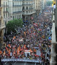 A demonstration organized by unions takes place in Barcelona. The protests held Thursday were the latest and biggest in an almost daily series of demonstrations that erupted last week when Prime Minister Mariano Rajoy announced measures to save 65 billion euros ($80 billion) and slash the public deficit