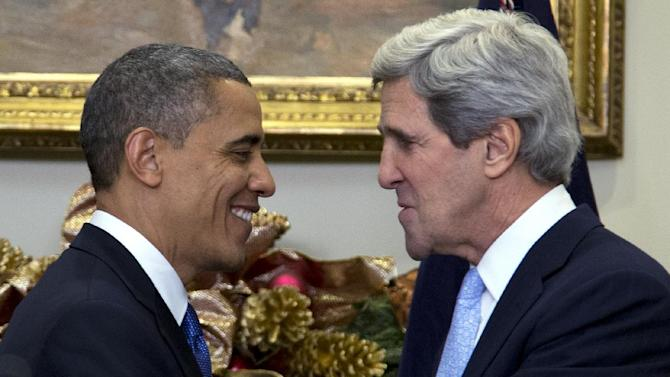 President Barack Obama looks to Sen. John Kerry, D-Mass., after announcing his nomination as the next secretary of state in the Roosevelt Room of the White House, Friday, Dec. 21, 2012, in Washington. (AP Photo/Carolyn Kaster)