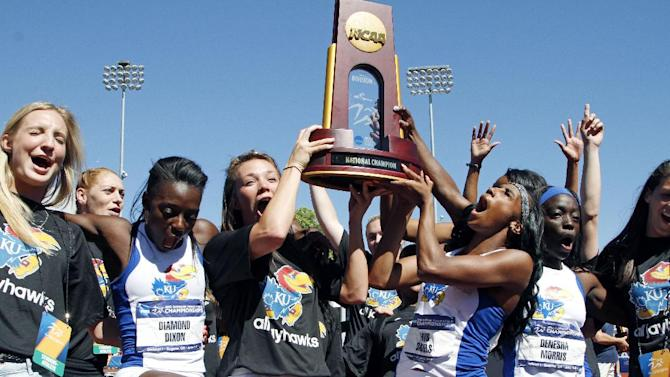 CORRECTS TO KANSAS NOT KANSAS STATE - Kansas women's track team celebrates after winning the NCAA outdoor track and field championships in Eugene, Ore., Saturday, June 8, 2013. (AP Photo/Don Ryan)