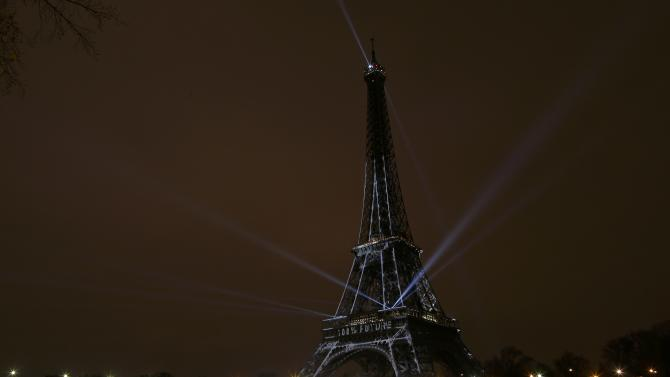 """The Eiffel Tower bears a message that reads, """"100% Future"""" ahead of the World Climate Change Conference 2015 (COP21), in Paris,"""