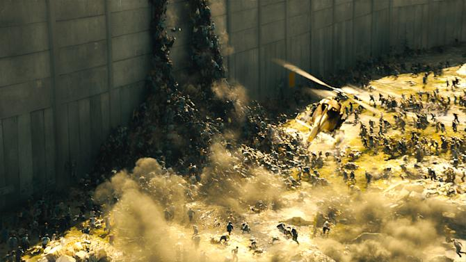 """This publicity image released by Paramount Pictures shows a scene from """"World War Z."""" The zombies in """"World War Z"""" move with Carl Lewis speed and a swarm-like mentality inspired in part by rabid dogs, furthering the eternal fan debate over whether the walking dead should actually run. (AP Photo/Paramount Pictures)"""