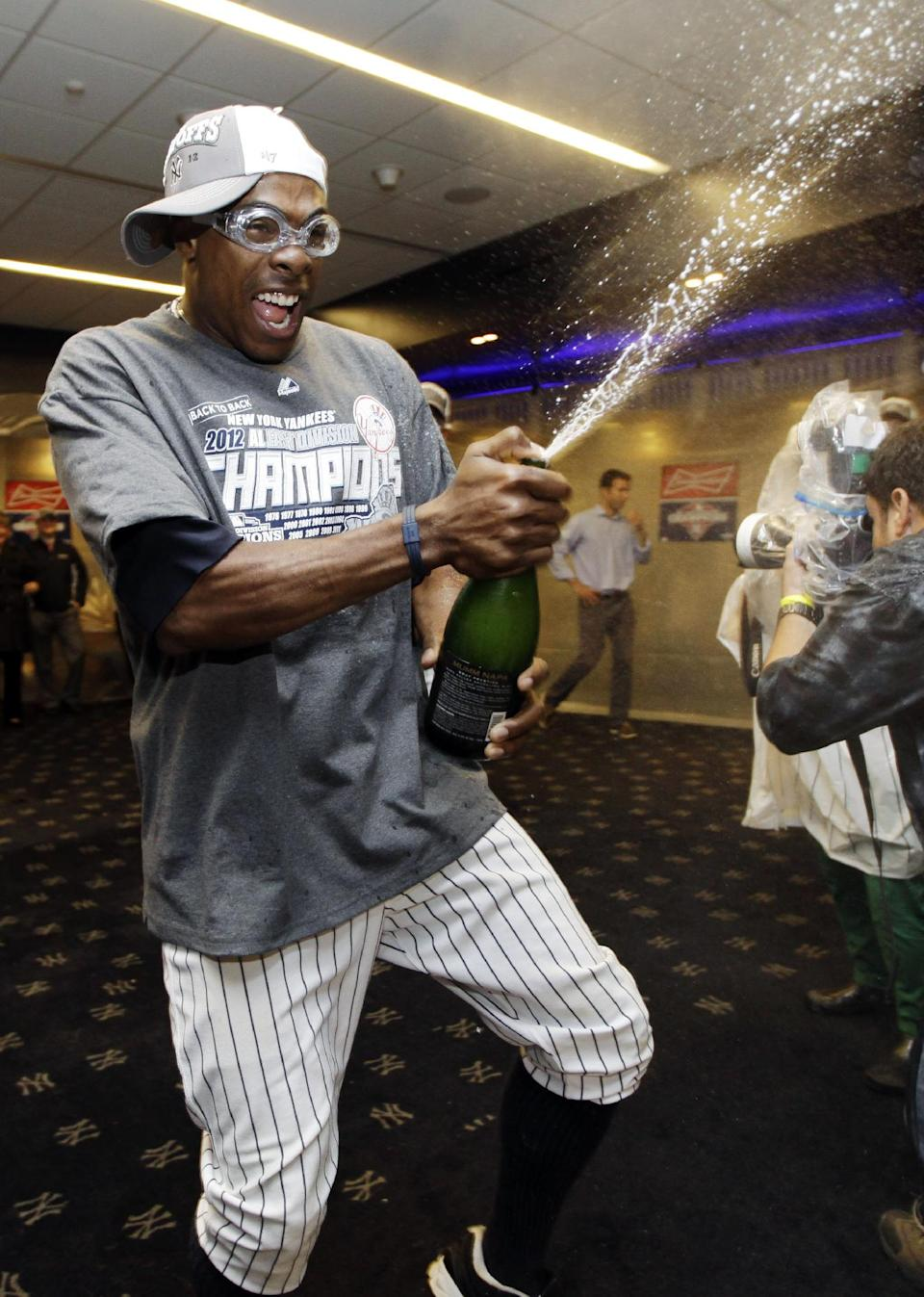 New York Yankees' Curtis Granderson celebrates in the clubhouse after their 14-2 win over the Boston Red Sox in a baseball game at Yankee Stadium in New York, Wednesday, Oct. 3, 2012. The Yankees clinched the American League East title. (AP Photo/Kathy Willens)