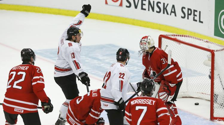 Switzerland's Julian Schmutz celebrates a goal on Canada during the second period of their IIHF World Junior Championship ice hockey game in Malmo