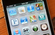 Apps on an iPhone 4S are pictured on December 13, 2012. WhatsApp&#39;s mobile messaging service used by hundreds of millions of customers worldwide breached privacy laws in at least two countries, a joint Canadian-Dutch probe concluded Monday