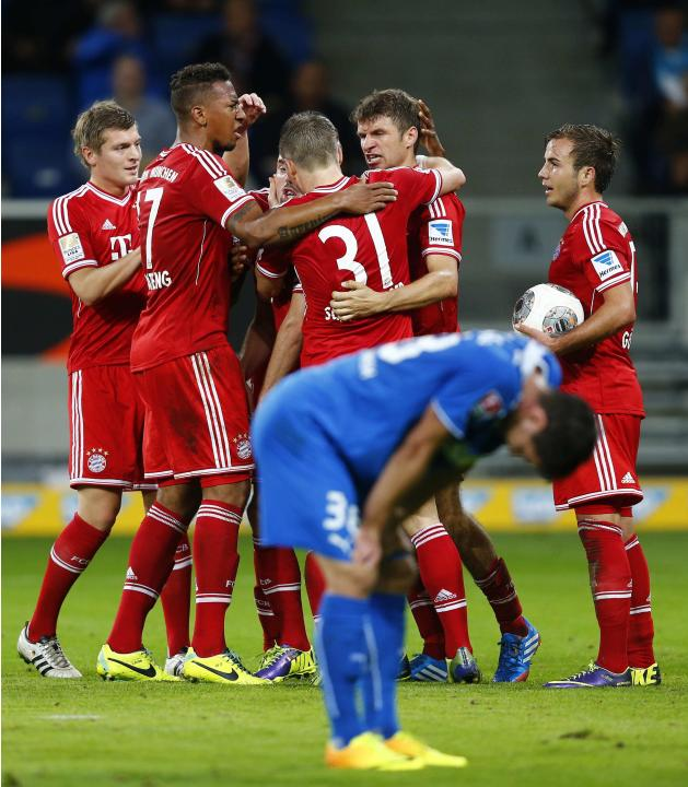 Bayern Munich's Mueller celebrates with his team mates after scoring his team's second goal against TSG Hoffenheim during their German first division Bundesliga soccer match in Sinsheim