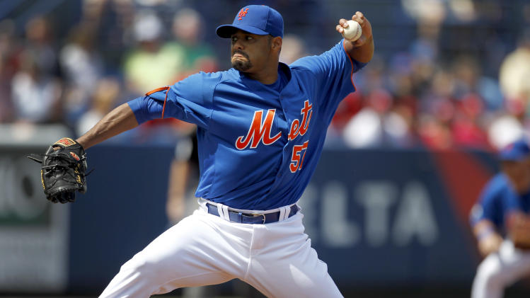 New York Mets starting pitcher Johan Santana throws during the first inning of a spring training baseball game against the St. Louis Cardinals,, Tuesday, March 6, 2012, in Port St. Lucie, Fla. (AP Photo/Jeff Roberson)