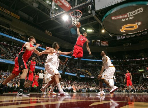 CLEVELAND, OH - DECEMBER 18:  DeMar DeRozan #10 of the Toronto Raptors goes up for the dunk against Anderson Varejao #17 and Alonzo Gee #33 of the Cleveland Cavaliers at The Quicken Loans Arena on December 18, 2012 in Cleveland, Ohio. (Photo by David Liam Kyle/NBAE via Getty Images)