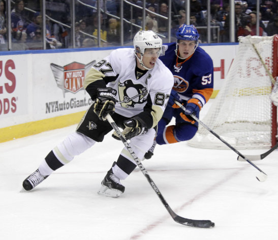Pittsburgh Penguins' Sidney Crosby, left, is chased by New York Islanders' Casey Cizikas during the first period of the NHL hockey game on Thursday, March 29, 2012, in Uniondale, N.Y. (AP Photo/Seth Wenig)