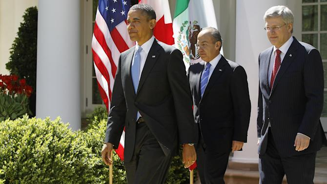 President Barack Obama, Mexico's President Felipe Calderon, and Canada's Prime Minister Stephen Harper arrive for a joint news conference in the Rose Garden at the White House in Washington, Monday, April 2, 2012. (AP Photo/Charles Dharapak)