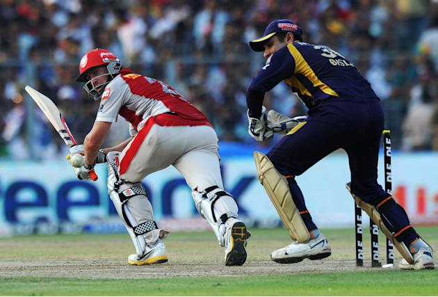 Kings XI Punjab batsman David Hussey (L)