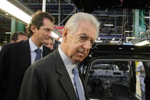Mario Monti (centre) visits a Fiat plant in Melfi, near Potenza last week. The Italian Prime Minister on Sunday gave his strongest signal yet that he may not run in February elections, just hours ahead of a news conference on his political future.