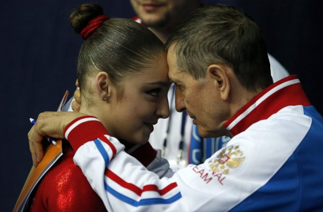 Russia's Mustafina is congratulated by the head coach Andrey Rodionenko after winning the women's all-around final at the European Men's and Women's Artistic Gymnastic individual Championships in Mosc