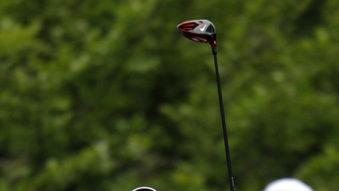 Rory McIlroy, of Northern Ireland, stretches on the fourth tee during the first round of the Wells Fargo Championship golf tournament at Quail Hollow Club in Charlotte, N.C., Thursday, May 2, 2013. (AP Photo/Bob Leverone)