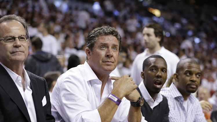 Former NFL quarterback Dan Marino watches play between the Miami Heat and the San Antonio Spurs during the first half of Game 1 of basketball's NBA Finals, Thursday, June 6, 2013 in Miami. (AP Photo/Lynne Sladky)
