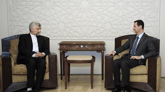 FILE - In this Tuesday, Aug. 7, 2012 photo provided by the Syrian official news agency SANA, Syrian President Bashar Assad, right, meets with Saeed Jalili, secretary of Iran's Supreme National Security Council, in Damascus, Syria. (AP Photo/SANA, FILE)