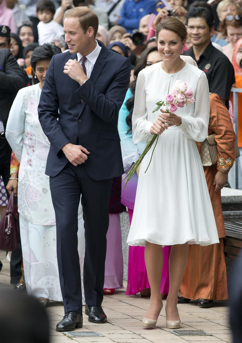 Prince William and his wife Kate, the Duke and Duchess of Cambridge take a walk through a central city park in Kuala Lumpur, Malaysia, Friday, Sept. 14, 2012. Prince William and Kate are on a nine-day tour of the Far East and South Pacific in celebration of Queen Elizabeth II's Diamond Jubilee. (AP Photo/Mark Baker)
