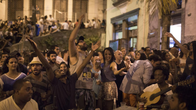 """This Sept. 7, 2012 photo shows people gathering to listen to live Samba music in a plaza called """"Pedra do Sal"""", or """"Stone of Salt"""" in Rio de Janeiro, Brazil. Rio's signature percussion-driven rhythm can be heard in classy indoor music venues, sure, but old-school samba circles can pop up without notice. (AP Photo/Felipe Dana)"""