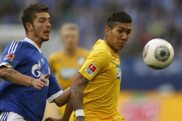 Schalke 04's Neustaedter challenges Hoffenheim's Firmino during the German first division Bundesliga soccer match in Gelsenkirchen