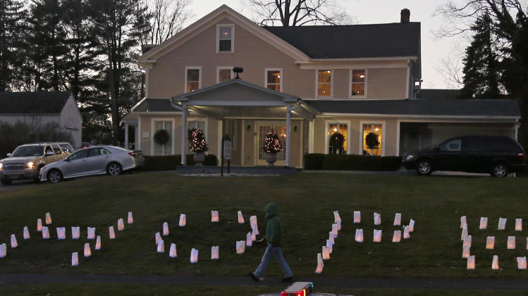 "The word ""HOPE"" is illuminated on the front lawn of a funeral home hosting the wake of Sandy Hook Elementary School principal Dawn Lafferty Hochsprung in Woodbury, Conn., Wednesday, Dec. 19, 2012. Hochsprung was killed when Adam Lanza walked into Sandy Hook Elementary School in Newtown, Conn., Dec. 14, and opened fire, killing 26 people, including 20 children, before killing himself. (AP Photo/Charles Krupa)"