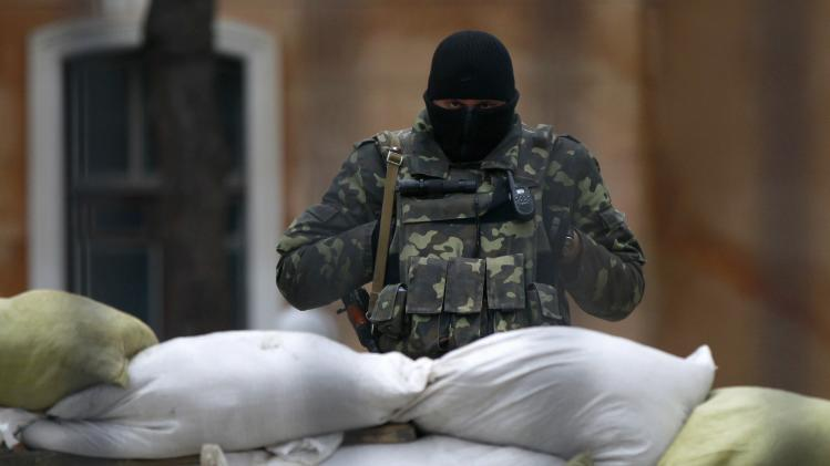 An Ukrainian soldier stands guard inside a military base in Simferopol