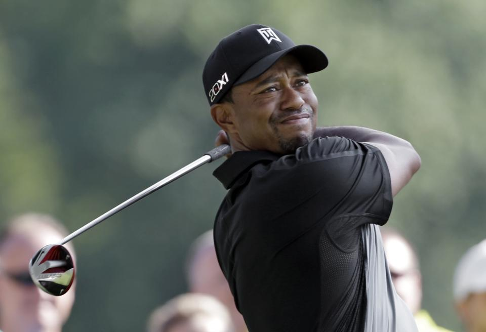 Tiger Woods watches his tee shot on the 11th hole during the first round of the Bridgestone Invitational golf tournament Thursday, Aug. 1, 2013 at Firestone Country Club in Akron, Ohio. (AP Photo/Mark Duncan)