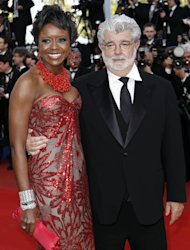 In this May 14, 2010 photo, Filmmaker George Lucas, right, and Mellody Hobson arrive for the screening of &quot;Wall Street Money Never Sleeps&quot;, at the 63rd international film festival, in Cannes, southern France. A spokeswoman for Lucasfilm said on Thursday, Jan. 3, 2013, the 68-year-old director is engaged to 43-year-old investment firm president Mellody Hobson. (AP Photo/Matt Sayles, File)