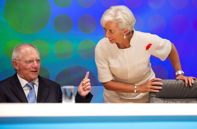 "In this photo released by the International Monetary Fund, IMF Managing Director Christine Lagarde, right, listens to German Finance Minister Wolfgang Schauble following the filming of the BBC World Debate ""Rescuing the Global Economy: What next?"" at the annual IMF and World Bank meetings in Tokyo Friday, Oct. 12, 2012. (AP Photo/Stephen Jaffe, IMF) EDITORIAL USE ONLY"